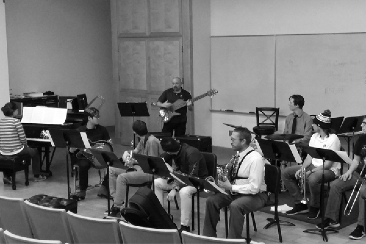 The Jazz Repertory Band rehearsing under direction of Denson Angulo shown playing the bass guitar.